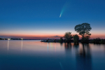 Comet C 2020 F3 Neowise in night sky above Dnieper river, Ukraine