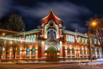 Stunning night scene of historical building of Noble and Peasant Bank in Poltava, Ukraine