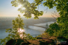 Sunrise over Danube river and Gellert hill park in Budapest