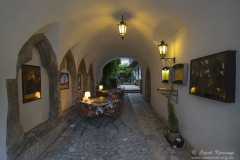 Medieval cafe in gateway of old building, Budapest, Hungary