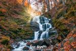 Autumn scenery with famous waterfall Shypit near Volovetz in Carpathian mountains, Ukraine