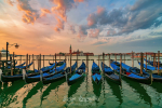 Stunning sunrise over Grand Canal in Venice, Italy. Gondolas moored on the San Marco basin